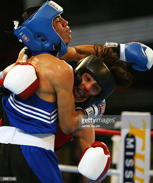 Aaron Alafa is tangled up with Raul Martinez during the United States Olympic Team Boxing Trials on February 19 2004 at Tunica Arena and Exhibition...