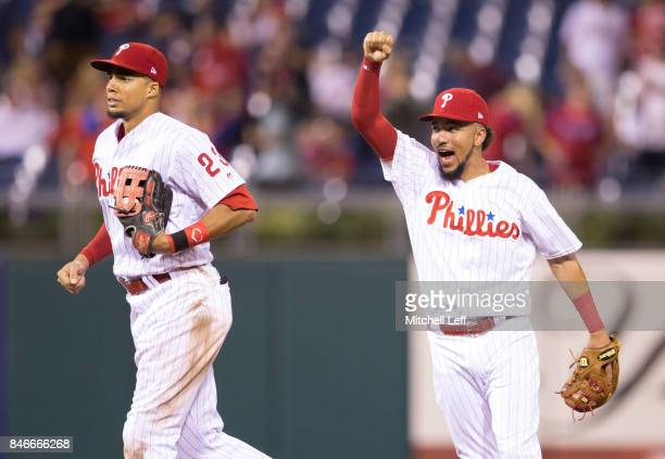Aaron Altherr and JP Crawford of the Philadelphia Phillies react at the end of the game against the Miami Marlins at Citizens Bank Park on September...