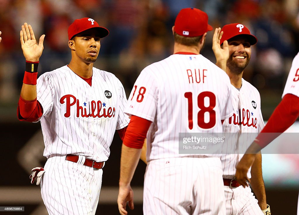 Aaron Altherr #40, Jeff Francoeur #3 and Darin Ruf #18 of the Philadelphia Phillies congratulate each other after defeating the San Diego Padres 7-1in a MLB game at Citizens Bank Park on August 28, 2015 in Philadelphia, Pennsylvania.