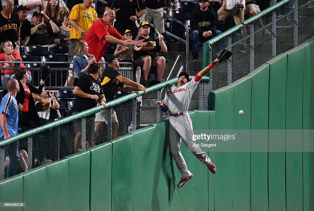 Aaron Altherr #23 of the Philadelphia Phillies attempts to catch a foul ball hit by Josh Bell #55 of the Pittsburgh Pirates (not pictured) during the sixth inning at PNC Park on May 19, 2017 in Pittsburgh, Pennsylvania.