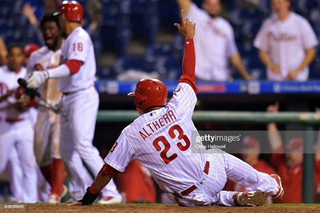 Aaron Altherr #23 of the Philadelphia Phillies celebrates after scoring the game winning run against the Miami Marlins in the 15th inning at Citizens Bank Park on September 12, 2017 in Philadelphia, Pennsylvania. The Phillies won 9-8.