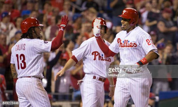 Aaron Altherr of the Philadelphia Phillies celebrates with Freddy Galvis and Ty Kelly after hitting a grand slam in the bottom of the sixth inning...