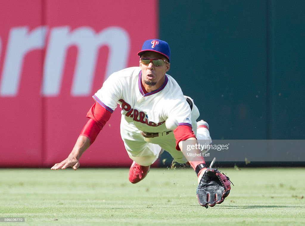 Aaron Altherr #23 of the Philadelphia Phillies dives for the ball and cannot make the catch on a ball hit by Jace Peterson #8 of the Atlanta Braves (NOT PICTURED) in the top of the seventh inning at Citizens Bank Park on September 4, 2016 in Philadelphia, Pennsylvania. The Braves defeated the Phillies 2-0.