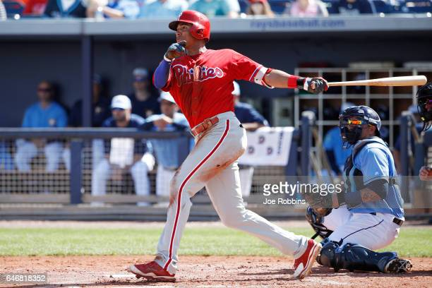 Aaron Altherr of the Philadelphia Phillies drives in three runs with a triple in the fourth inning of a Grapefruit League spring training game...
