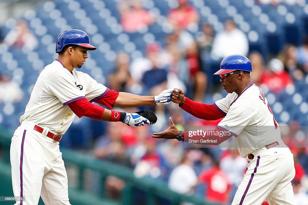 Aaron Altherr #40 of the Philadelphia Phillies fist bumps first base coach Juan Samuel #8 after Altherr hit a double in the third inning of the game against the Chicago Cubs at Citizens Bank Park on September 13, 2015 in Philadelphia, Pennsylvania. The Phillies won 7-4.