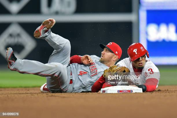 Aaron Altherr of the Philadelphia Phillies gets picked off at second base by Cliff Pennington of the Cincinnati Reds in the 10th inning at Citizens...