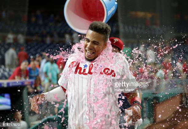 Aaron Altherr of the Philadelphia Phillies gets Powerade dumped on him by Rhys Hoskins after hitting a game winning tworun double in the 10th inning...
