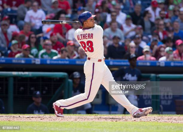Aaron Altherr of the Philadelphia Phillies hits a solo home run in the bottom of the eighth inning against the Atlanta Braves at Citizens Bank Park...