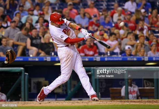 Aaron Altherr of the Philadelphia Phillies hits a solo home run in the fifth inning during a game against the Atlanta Braves at Citizens Bank Park on...