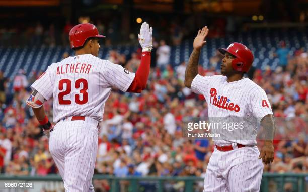 Aaron Altherr of the Philadelphia Phillies is congratulated at home plate by Howie Kendrick after hitting a tworun home run in the third inning...