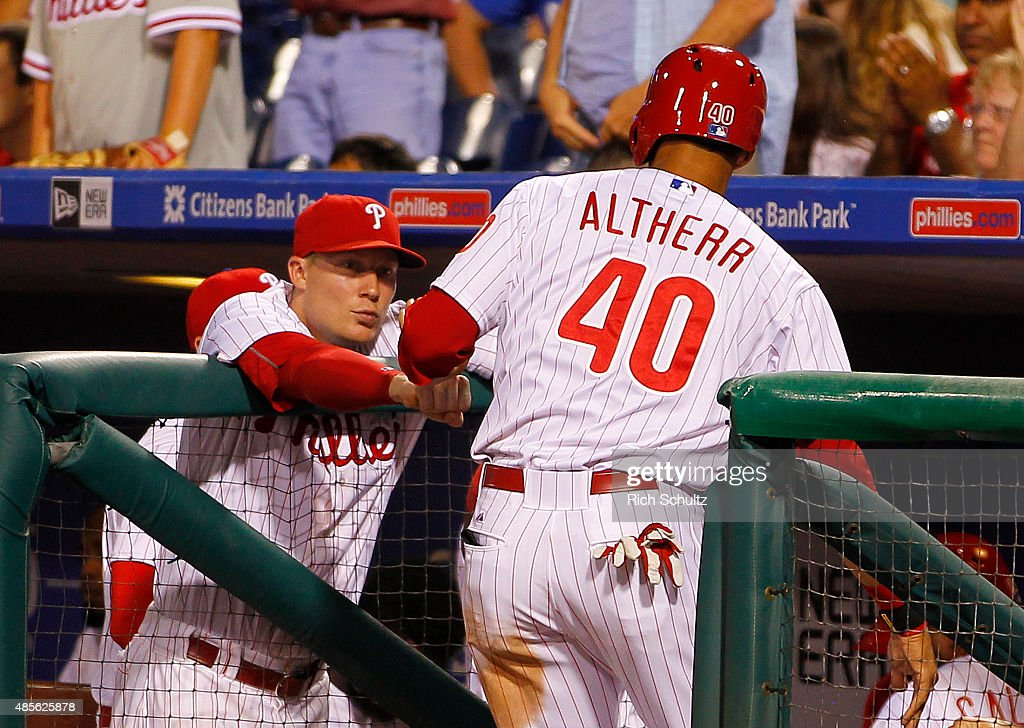 Aaron Altherr #40 of the Philadelphia Phillies is congratulated Cody Asche #25 after scoring on a double by Jeff Francoeur #3 in the eighth inning of a MLB game at Citizens Bank Park on August 28, 2015 in Philadelphia, Pennsylvania. The Phillies defeated the Padres 7-1.