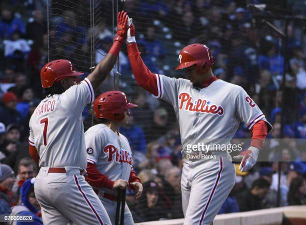 Aaron Altherr of the Philadelphia Phillies is greeted by Maikel Franco after hitting a home run against the Chicago Cubs during the first inning on...