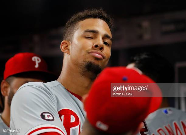 Aaron Altherr of the Philadelphia Phillies reacts after hitting a tworun homer in the eighth inning against the Atlanta Braves at SunTrust Park on...
