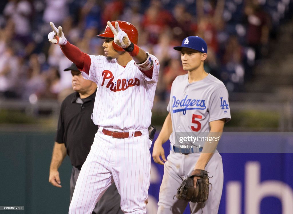 Aaron Altherr #23 of the Philadelphia Phillies reacts in front of Corey Seager #5 of the Los Angeles Dodgers after hitting a two run single and advances to second base on the throw in the bottom of the eighth inning at Citizens Bank Park on September 20, 2017 in Philadelphia, Pennsylvania. The Phillies defeated the Dodgers 7-5.