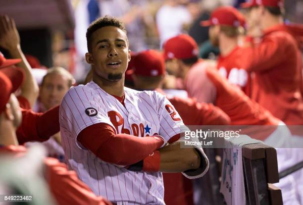 Aaron Altherr of the Philadelphia Phillies reacts in the dugout after hitting a grand slam in the bottom of the sixth inning against the Los Angeles...
