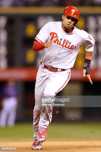 Aaron Altherr of the Philadelphia Phillies scores on a Nick Williams double in the sixth inning against the Colorado Rockies at Coors Field on August...