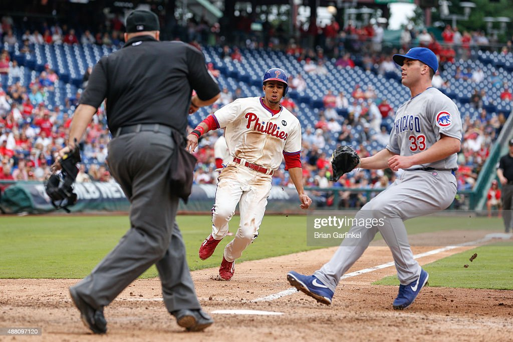 Aaron Altherr #40 of the Philadelphia Phillies scores on a wild pitch in the seventh inning of the game against the Chicago Cubs at Citizens Bank Park on September 13, 2015 in Philadelphia, Pennsylvania. The Phillies won 7-4.