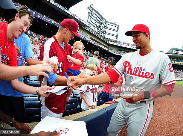 Aaron Altherr of the Philadelphia Phillies signs autographs before the game against the Atlanta Braves at Turner Field on July 30 2016 in Atlanta...
