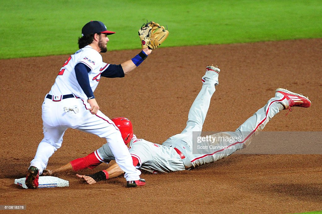 Aaron Altherr #23 of the Philadelphia Phillies steals second base against Dansby Swanson #2 of the Atlanta Braves in the seventh inning at Turner Field on September 27, 2016 in Atlanta, Georgia.