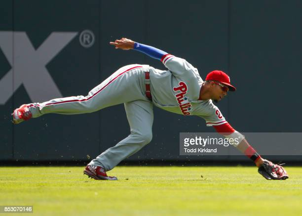 Aaron Altherr of the Philadelphia Phillies stretches out to field a ball in the first inning of an MLB game against the Atlanta Braves at SunTrust...