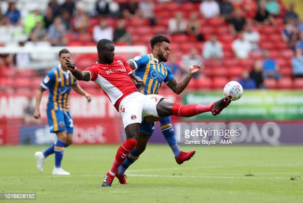 Aaron AmadiHolloway of Shrewsbury Town and MahamadouNaby Sarr of Charlton Athletic during the Sky Bet League One match between Charlton Athletic and...