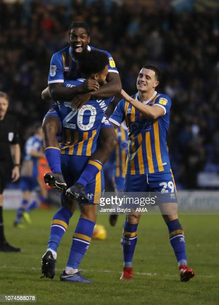 Aaron AmadiHolloway of Shrewsbury Town celebrates after scoring a goal to make it 10 with Anthony Grant and Oliver Norburn of Shrewsbury Town during...