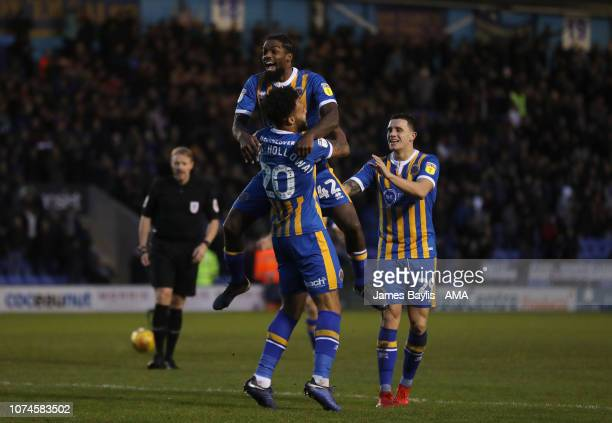 Aaron AmadiHolloway of Shrewsbury Town celebrates with his team mates after scoring a goal to make it 10 during the Sky Bet League One match between...