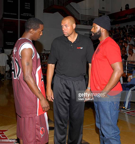 Aaron AO Owens of the Ball Up AllStars coach Tracy Murray and Baron Davis at the Ball Up Championship Game at Cal State Northridge on June 24 2011 in...