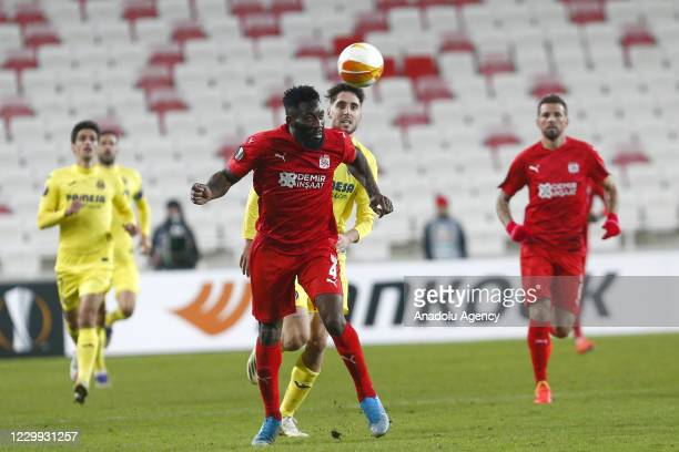 Aaron Appindangoye of Demir Grup Sivasspor in action against his opponent during UEFA Europa League Group I match between Demir Grup Sivasspor and...