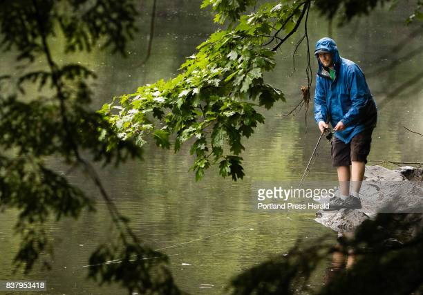 Aaron Armiento of Hollis gets some casts into the Saco River in Buxton on a rainy Friday afternoon before work Armiento who was hoping to catch some...