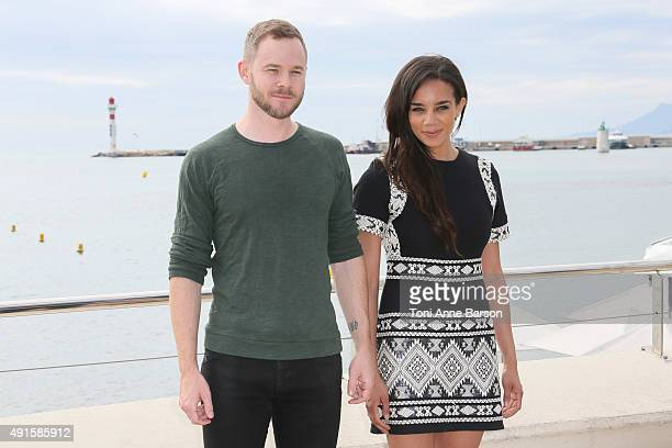 Aaron Ashmore and Hannah JohnKamen attend Killjoys photocall on La Croisette on October 6 2015 in Cannes France