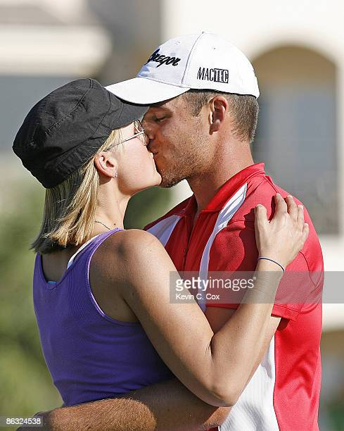 Aaron Baddeley kisses his wife Richelle on the 18th green after winning the 2006 Verizon Heritage Classic Sunday April 16 at Harbour Town Golf Links...