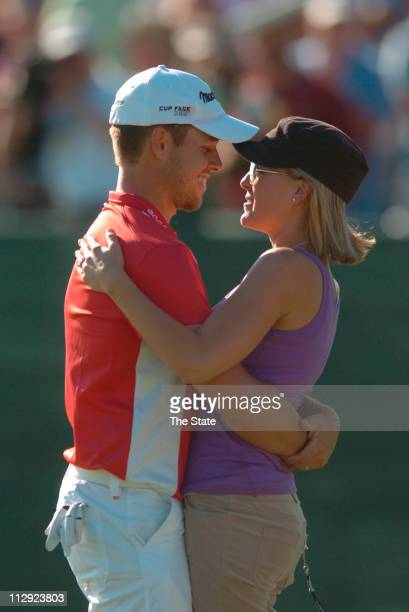 Aaron Baddeley left hugs his wife Richelle Baddeley right after winning the 2006 Verizon Heritage of Golf on Harbour Town Golf Links in Hilton Head...
