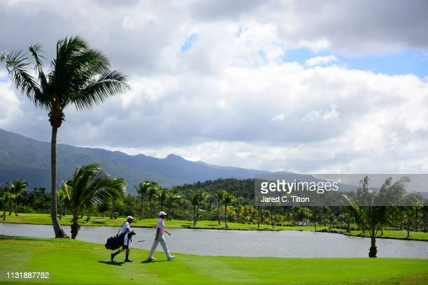 Aaron Baddeley of Australia and his caddie walk the third hole during the final round of the Puerto Rico Open at Coco Beach Golf and Country Club on...