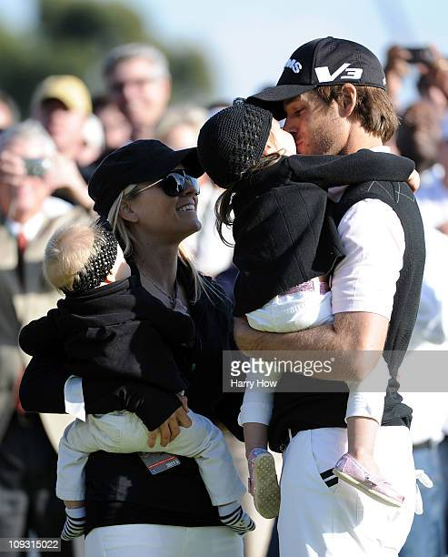 Aaron Baddeley of Australia celebrates his win with daughter Jewell wife Richelle and daughterJolee on the side of the 18th green during the fourth...
