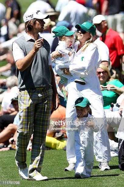 Aaron Baddeley of Australia chats with his wife Richelle and daughters Jewell and Jolee during the Par 3 Contest prior to the 2011 Masters Tournament...