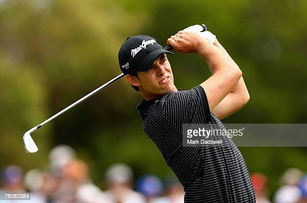 Aaron Baddeley of Australia hits his second shot on the sixth hole during round four of the MasterCard Masters at Huntingdale Golf Course on November...