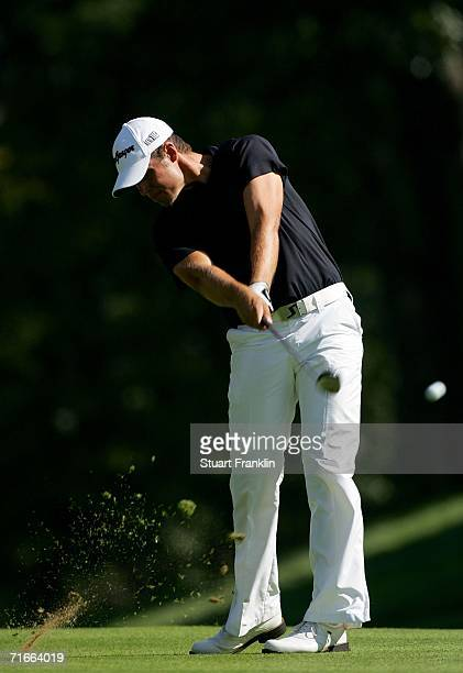 Aaron Baddeley of Australia hits off of the fairway on the 14th hole during the first round of the 2006 PGA Championship at Medinah Country Club on...