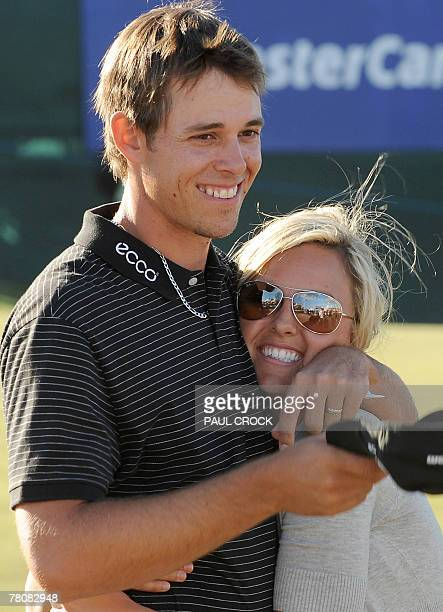 Aaron Baddeley of Australia hugs his wife Richelle after winning the Australian Masters golf tournament after beating Daniel Chopra of Sweden on the...