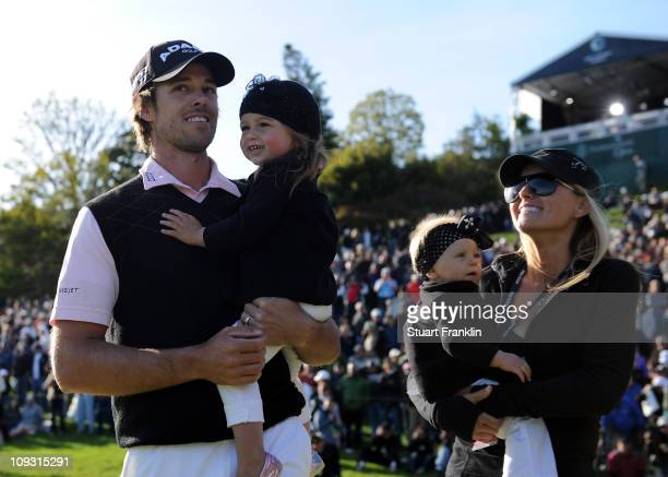 Aaron Baddeley of Australia is congratulated by his wife Richelle Baddeley and children Jewell and Jolee after the final round of the Northern Trust...