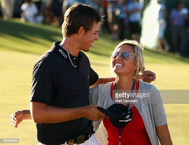 Aaron Baddeley of Australia is congratulated by his wife Richelle after winning the MasterCard Masters at Huntingdale Golf Course on November 25 2007...