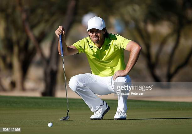 Aaron Baddeley of Australia lines up a putt on the second hole during the first round of the Waste Management Phoenix Open at TPC Scottsdale on...