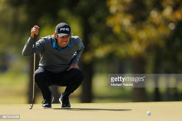 Aaron Baddeley of Australia looks over a putt on the third hole during the third round of the Sanderson Farms Championship at the Country Club of...