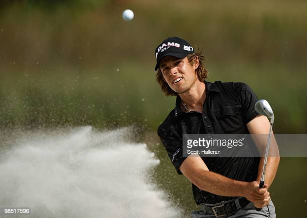 Aaron Baddeley of Australia plays a bunker shot on the 17th hole during the third round of the Verizon Heritage at the Harbour Town Golf Links on...