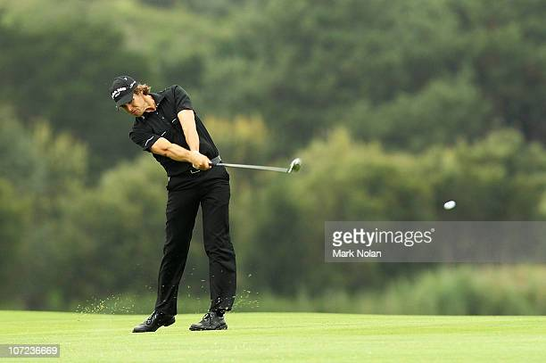Aaron Baddeley of Australia plays a shot on the 17th hole during day one of the Australian Open at The Lakes Golf Club on December 2 2010 in Sydney...