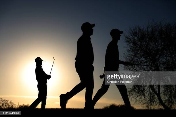 Aaron Baddeley of Australia plays his shot from the 12th tee as Harold Varner III and Chesson Hadley walk to the green during the second round of the...