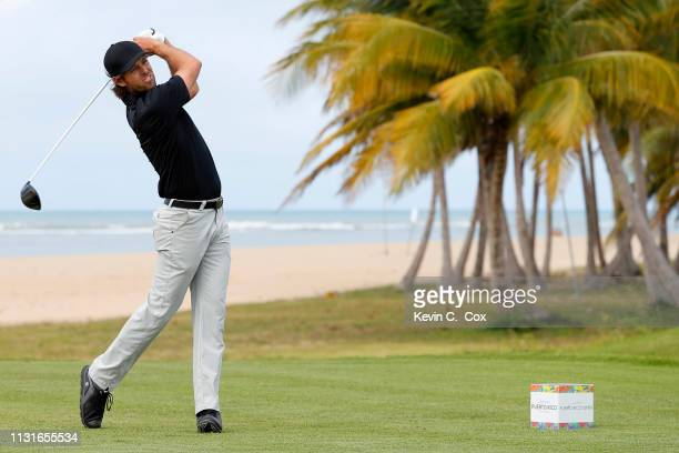 Aaron Baddeley of Australia plays his shot from the 13th tee during the third round of the Puerto Rico Open at Coco Beach Golf and Country Club on...
