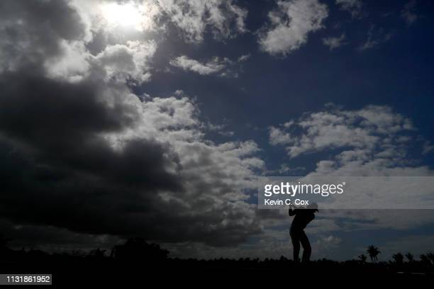 Aaron Baddeley of Australia plays his shot from the eighth tee during the final round of the Puerto Rico Open at Coco Beach Golf and Country Club on...