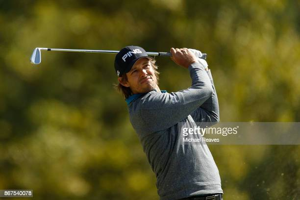 Aaron Baddeley of Australia plays his shot from the fourth tee during the third round of the Sanderson Farms Championship at the Country Club of...