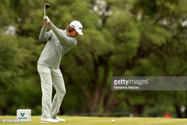 Aaron Baddeley of Australia plays his shot from the second tee during the third round of the Valero Texas Open at TPC San Antonio ATT Oaks Course on...